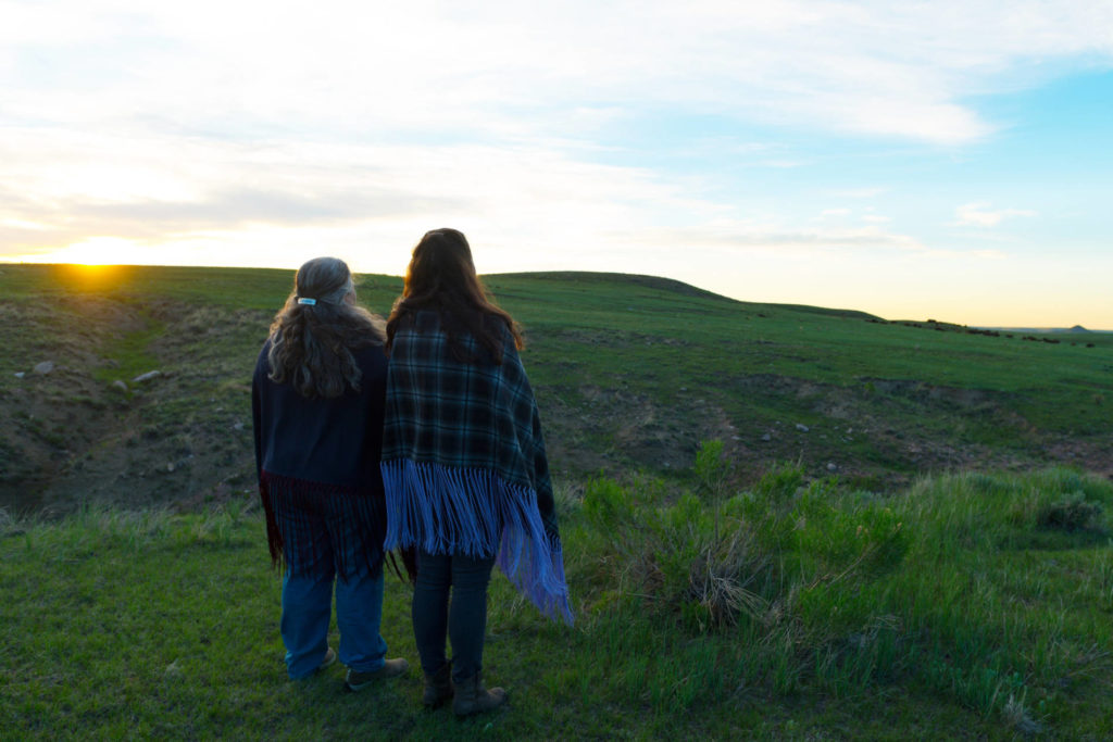 CSU Ethnic Studies professors Lindsey Schneider and Doreen Martinez look out over the land at Soapstone Prairie Natural Area.