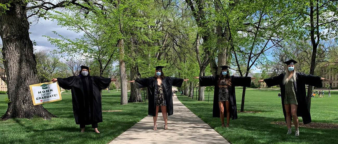 Joyce McConnell and graduates on the Oval at CSU