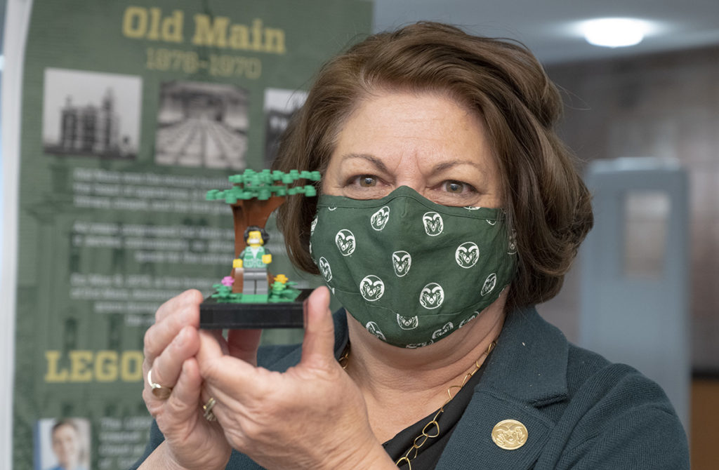 President Joyce McConnell holds up a Lego minifigure of herself.