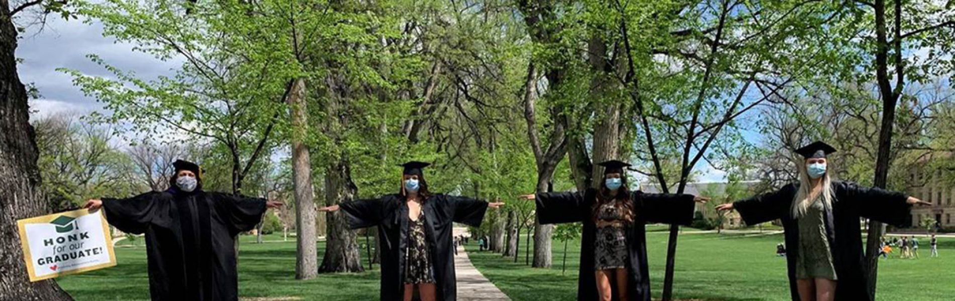 President McConnell joins Colorado State University graduates in regalia in a physically distanced celebration on the Oval at Colorado State University.